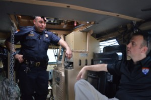 SWAT team members Sheriff's Deputy Jerry Droddy, left, speaks with Deputy Marcus Mclellan in the sheriff office's armored rescue vehicle.  Mary Meaux/The News
