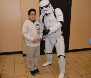 Kristofer Camacho, 9, of Nederland poses for a photo with a Storm Trooper at Central Mall on Friday. The Star Wars characters were on hand Friday for the Star Wars: The Force Awakens movie premier. Mary Meaux/The News