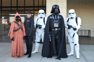 Licensed Star Wars characters were on hand to pose for photos with movie-goers and fans for the Star Wars: The Force Awakens movie premier at Central Mall on Friday. Mary Meaux/The News