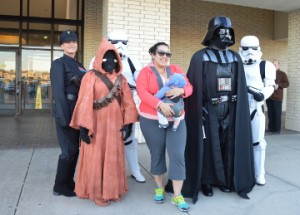 Star Wars fan Stephanie Cruz, who is also the mother of Kristofer Camacho, poses for a photo with Star Wars characters. Mary Meaux/The News