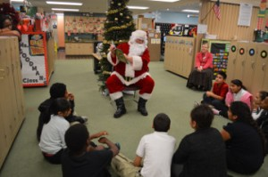 Santa Claus reads Pete the Cat Saves Christmas to Dowling Elementary School students during Y Reads With You, Literacy Program with the help of Flint Hills Resources Port Arthur volunteers on Wednesday. Mary Meaux/The News