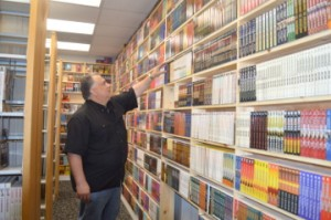 Dale LaFleur, owner of LaFleur Fine Books, shows the romance and western novel section of his newly opened store in Port Neches. Mary Meaux/The News