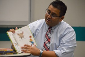 Nederland City Manager Chris Duque reads from the book If You Give a Mouse a Cookie during a children's program celebrating National Chocolate Chip Cookie Day one day early at the Marion and Ed Hughes Public Library in Nederland on Wednesday.  Mary Meaux/The News