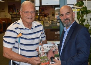 """Nederland Mayor Richard """"Dick"""" Nugent, left, receives one of the very first copies of Greater Port Arthur the Magazine from Port Arthur News Publisher Rich Macke at the Marian and Ed Hughes Public Library in Nederland on Thursday. Mary Meaux/The News"""