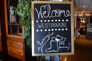 A sign welcomes Westernaire alumni to a luncheon in their honor at the Pompano Club in Port Neches on Saturday. Mary Meaux/The News