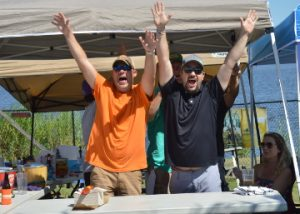 Daniel Tentrup, left, and Jason Vice, members of Team Chililicious, let out a cheer as they were named winners of the Wheelhouse Chili Cook-Off in Port Neches on Saturday. Mary Meaux/The News