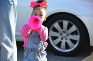 Khloe Joubert, 2, cheers for her brother Tony Brooks who is quarterback at Thomas Jefferson Middle School.  Mary Meaux/The News