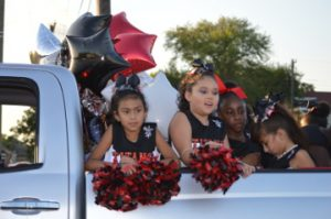 Elementary school cheerleaders take part in the Memorial High School Homecoming Parade on Wednesday. Mary Meaux/The News