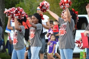 Dowling Elementary School students cheer during the Memorial High School Homecoming Parade on Wednesday. Mary Meaux/The News
