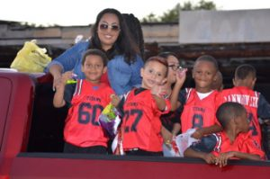 Some little football players toss candy during the Memorial High School Homecoming Parade on Wednesday. Mary Meaux/The News