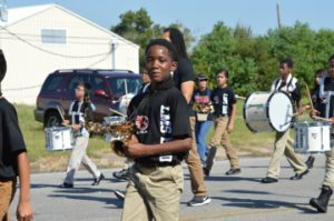 GeRacio Pete with Lincoln Middle School marches in the parade. Mary Meaux/The News