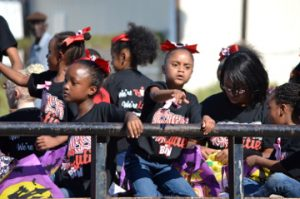 Elementary school students toss candy during the parade. Mary Meaux/The News