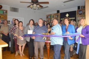 Fleur Fine Books held a ribbon cutting celebrating their grand opening along with members of the Port Neches and Port Arthur chambers of commerce on Wednesday. Mary Meaux/The News