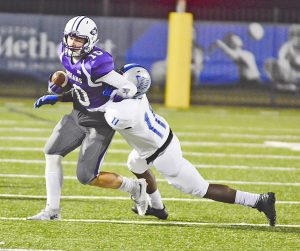Port Neches-Groves receiver Dylan McGough hauls in a pass in front of Fort Bend Willowridge defender Christian Carter Friday evening. (Gabriel Pruett/The News)