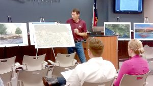 Bill Worsham, director of Coastal Engineering, shows different development scenarios for the riverfront in Port Neches during the Port Neches Riverfront Planning and Design Public Input Meeting at city hall in August.