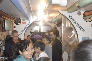 Students, teachers and instructors stand inside the 40-foot science-themed trailer of the Trailblazer at DeQueen Elementary. (Lorenzo Salinas/The News)
