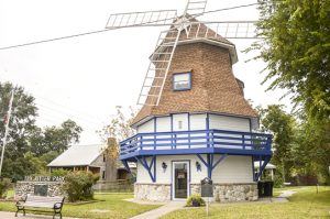 A historical marker in front of the Dutch Windmill Museum pays homage to Nederland's first settlers. (Mary Meaux/The News)