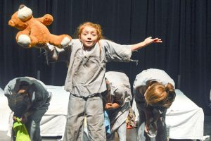 """Students from several elementary and middle schools rehearse their song and dance routine as orphans for """"Annie: The Musical."""" (Lorenzo Salinas/The News)"""