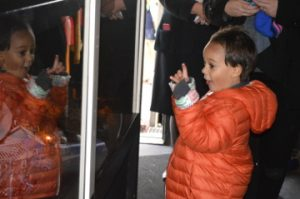 Andre Thomas, 4, reacts to seeing a miniature train and Christmas scene inside the Kansas City Southern Holiday Express train on Thursday. Mary Meaux/The News