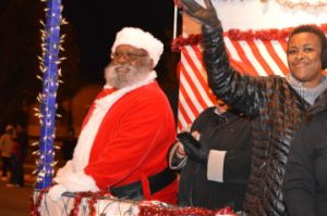 Santa Claus waves to the crowd during Port Arthur's Annual Cultural Lighted Christmas Parade on Procter Street on Friday. Mary Meaux/The News