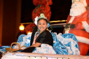 A member of the Mexican Heritage Society's royal court rides in Port Arthur's Annual Cultural Lighted Christmas Parade on Procter Street on Friday. Mary Meaux/The News