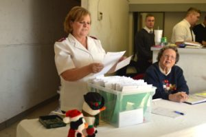 Salvation Army Maj. Nancy Fuller, left, and Glenda Donnell, assists with toy distribution in Groves on Tuesday. Mary Meaux/The News