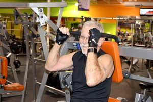 John Dougher, 68, works his core on an ab machine at Exygon Health and Fitness Club in Nederland. (Lorenzo Salinas/The News)