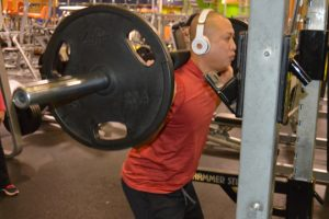 Anthony Do performs squats with a barbell. (Lorenzo Salinas/The News)