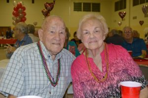 J.D. and Pattye Mire sit together to celebrate their 72-year marriage at the annual Valentine party hosted by Walgreens at the OCAW hall in Port Arthur. (Lorenzo Salinas/The News)