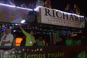 The Richard Industrial Group passes by with a festive gathering on its float. (Lorenzo Salinas/The News)