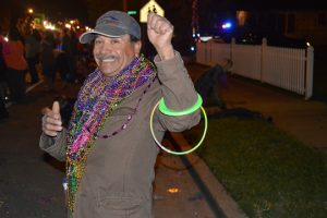 A happy onlooker who had collected many beads during the parade. (Lorenzo Salinas/The News)